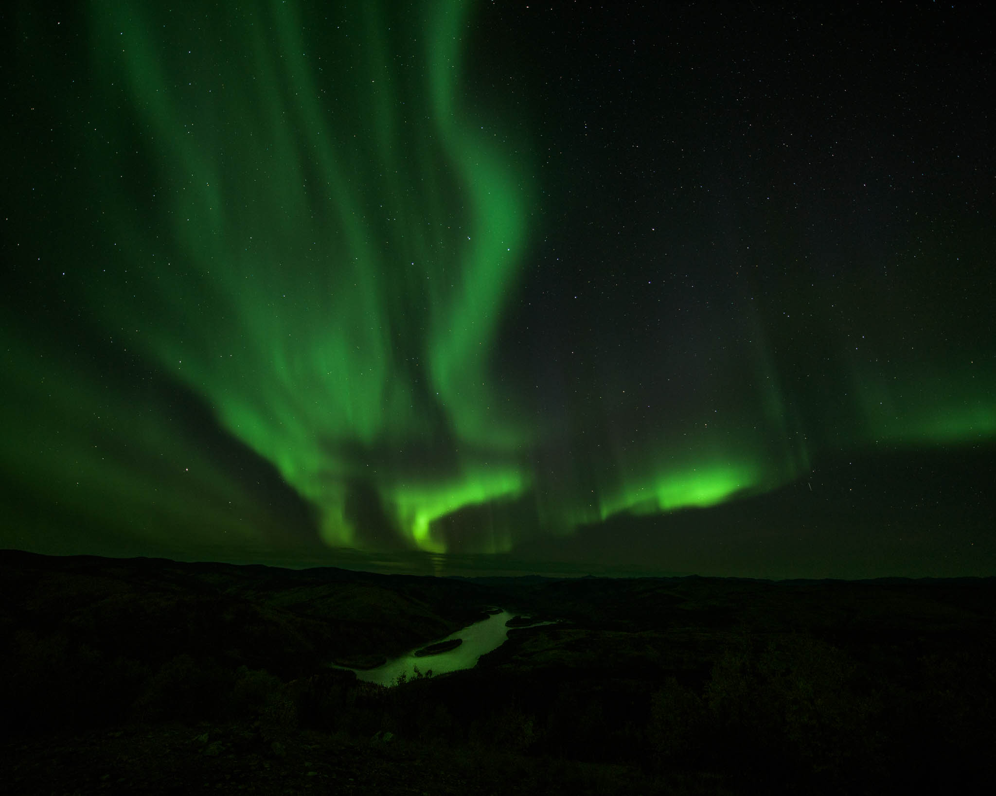 Yukon River lit up by the Northern Lights